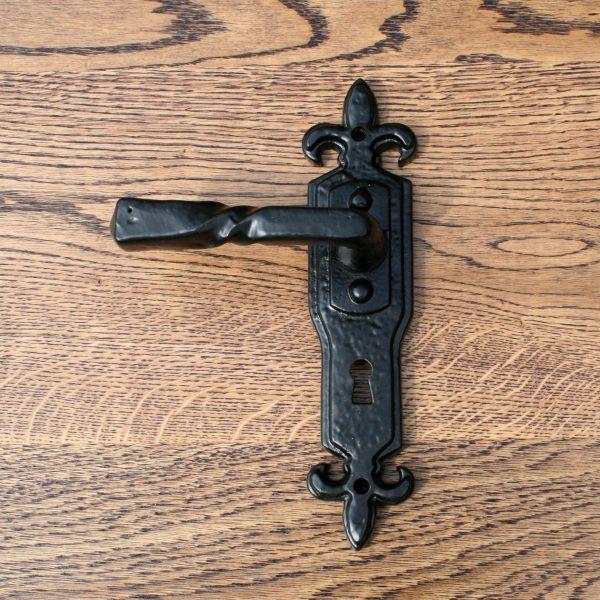 black fleur de lys door handle